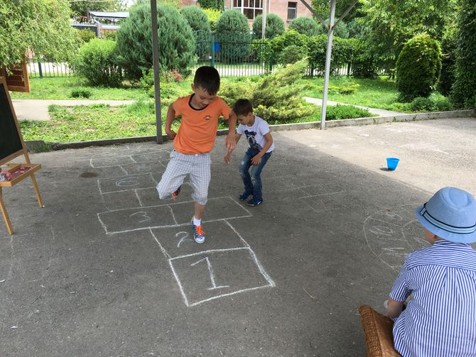 Playing hopscotch kids